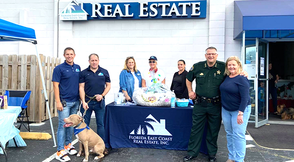 Brevard Sheriff Wayne Ivey Visits 'A Home For The Holidays' Event Hosted by Florida East Coast Real Estate Inc.