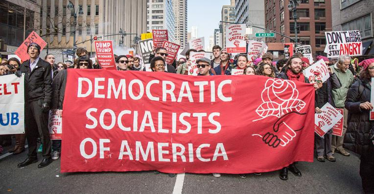 Socialists Denounced as Foes and Tools of Real Estate Industry